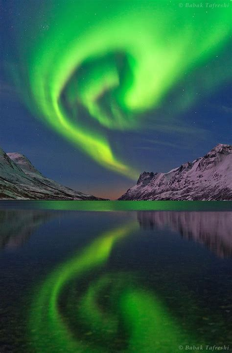 when are the northern lights in norway the northern lights or aurora borealis swirls over a fjord