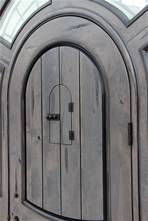 rustic arched door  faux finish