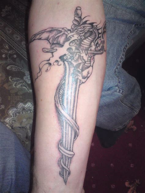 sword in the stone tattoo designs sword tattoos designs ideas and meaning tattoos for you