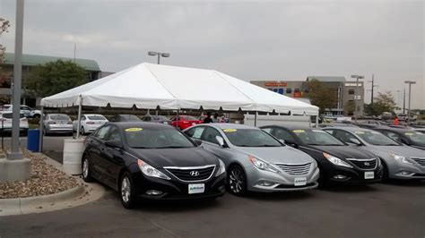 tent for the grand re opening at coralville used car