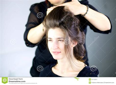 Gets Hair Done by Beautiful Model Getting Hair Done By Professional