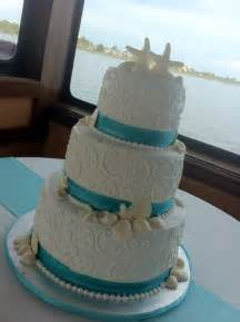 jessica 3 tier white wedding cake with seashells swirls and aqua ribbon border feeds 100 msrp