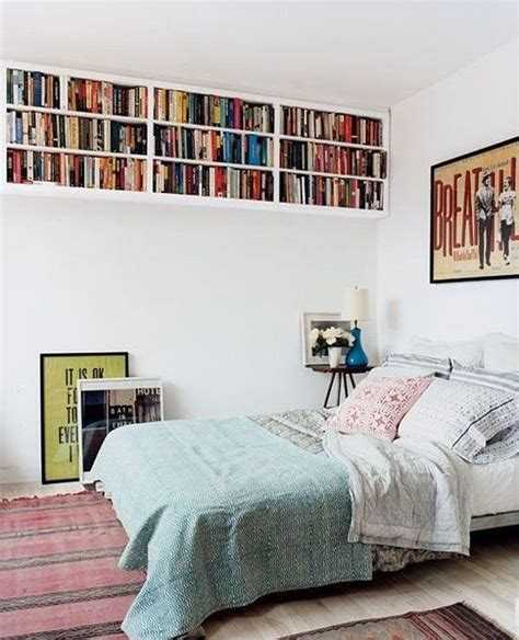 small room with high celings small bedroom high ceiling books storage home decorating