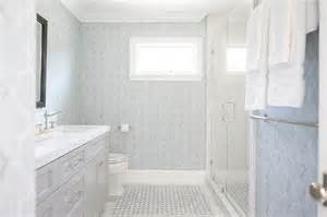 blue and gray bathroom with light gray washstand and