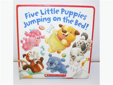 five little puppies jumping on the bed board book