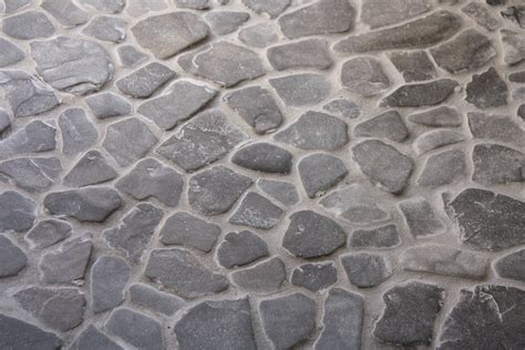 Painted Wall Designs by Grouting A Diy Beach Stone Floor Merrypad