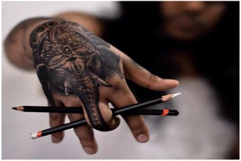 elephant tattoo in hand getting a tattoo here s what you should consider idkmen