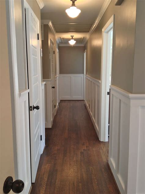 beautiful wainscoting and crown molding for the hallway wall color sherwin williams pavestone