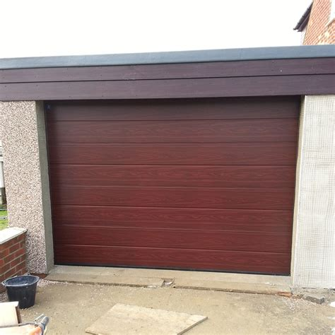 Building Garage Doors by Build Sectional Garage Images