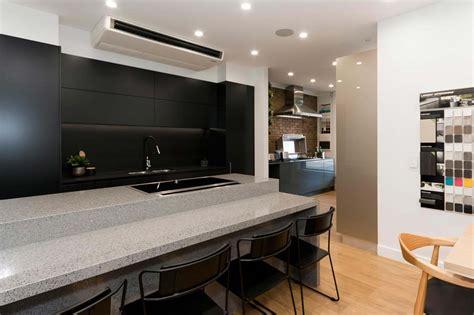 essa stone bench tops dulux domino polyurethane cabinets black kitchen design