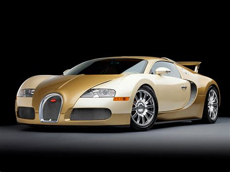 gold and white bugatti veyron car stock photos kimballstock
