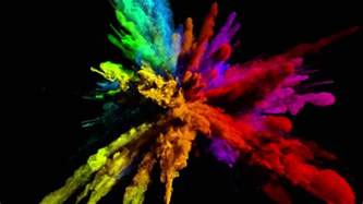 color powder cg animation of color powder explosion on black background