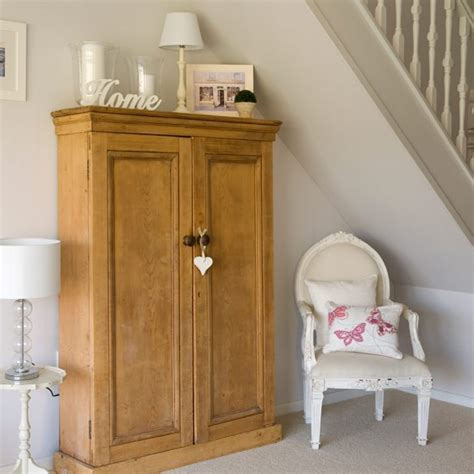 classic country hallway hallway decorating ideas hallway with understairs cupboard and chair small