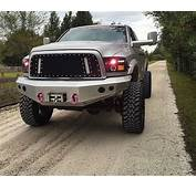 Lifted Silver Grey Doge Ram Truck  Front Grille View