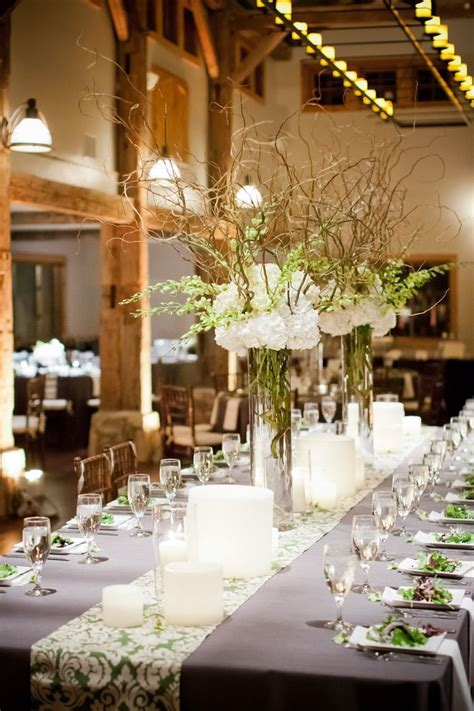 White hydrangeas, baby's breath and curly willow branches