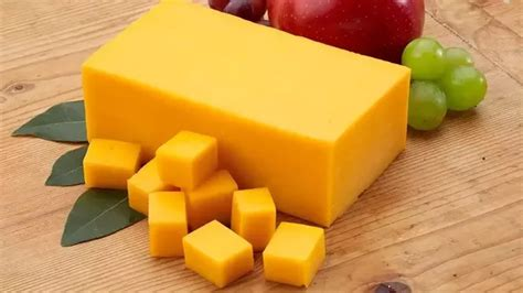 what color is cheddar cheese which is healthier american cheese or cheddar and why