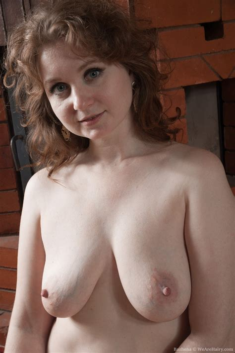 Bazhena Is Relaxing By Her Fireplace And Stripping Off Her Dress Lingerie And Stockings She