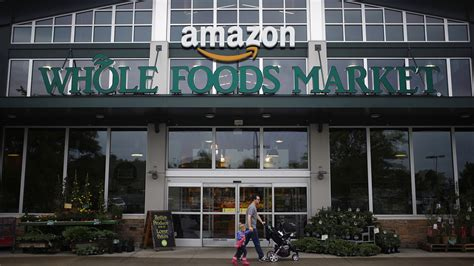 amazon whole foods amazon says it s buying whole foods and the half price