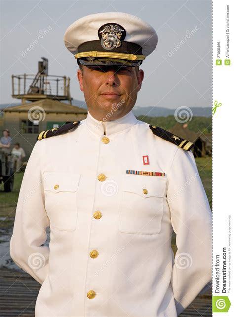 Officer White navy officer smiling in dress white editorial