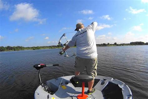 fishing and bowfishing from a one man round boat - One Man Fishing Boat