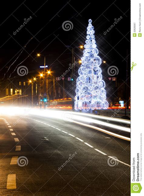 christmas tree on a road royalty free stock photography