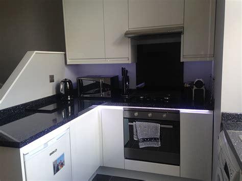 Black Gloss Kitchen With White Worktops by Danielle Sale Manchester Lp Kitchen Installations