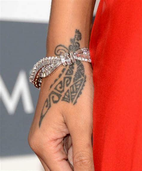 in pics rihanna s all of the 20 tattoos catch news