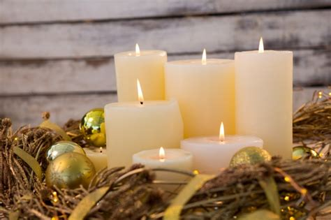 white candles lit  christmas decoration photo