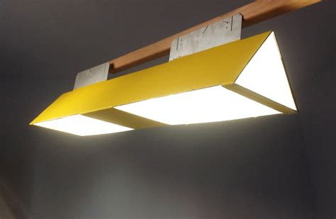 Sustainable Light Fixtures Flat Pack Led World L Is Made From Lightweight Recycled Materials Inhabitat Green Design