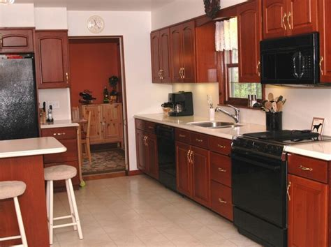 Black Kitchen Cabinets With Black Appliances by Cashmere White Granite Touches Kitchen Interior With