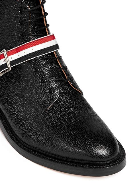 thom browne belted pebbled leather ankle boots in black
