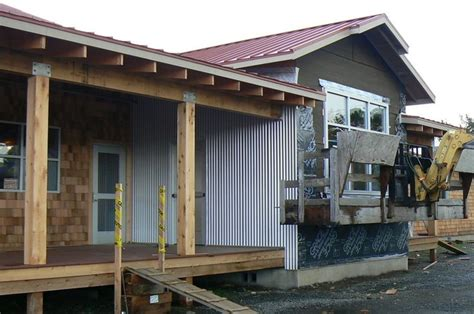 houses with metal siding metal siding for houses building the corrugated metal brings contrast to the