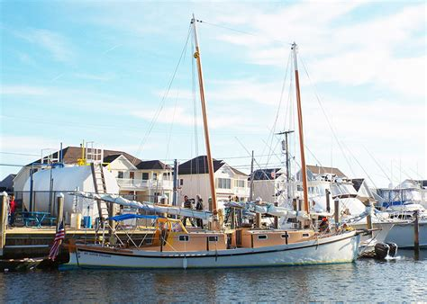 wooden boat nj ibis at the fuel dock in new jersey