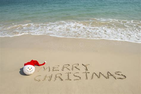 merry christmas written  tropical beach white sand  snowman stock image image  date