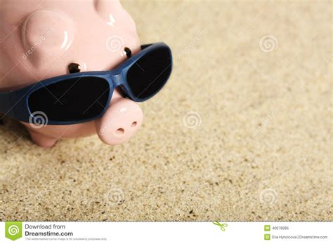 summer bank summer piggy bank with sunglasses standing on the