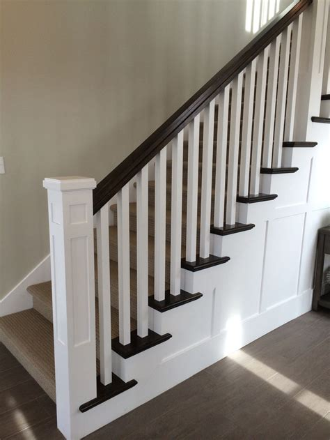 black banister white spindles white newel post charcoal stained handrail white square