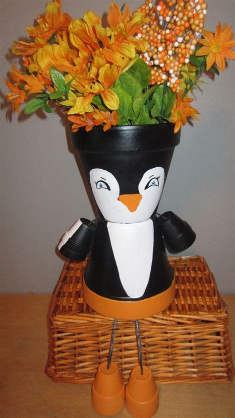 Animal Flower Pot Penguin 290 best images about clay pot creations on