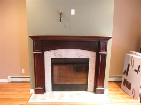 white marble feat brown fireplace mantle surround
