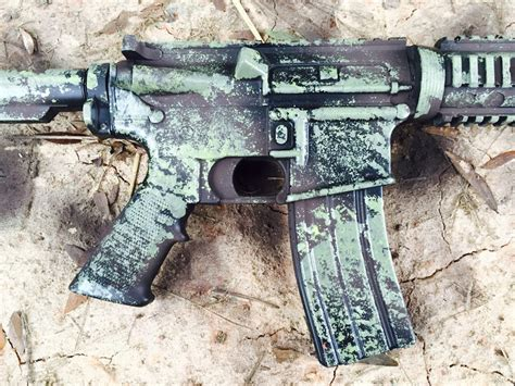 spray painting a gun blue gear how to camo your rifle with a sponge