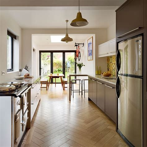 Open Plan Galley Kitchen - galley kitchen with parquet flooring be inspired by a vibrant retro 1960s family kitchen