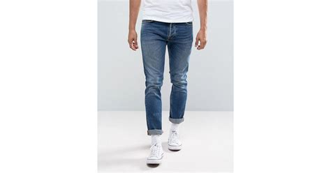 Nudie Tilted Tor Shackled And Blue nudie co tilted tor jean fit shackled and blue mid wash in blue for lyst