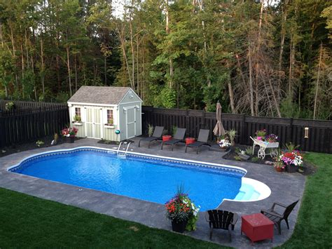 roman pool roman backyard and swimming pools 16x32 roman end with brown sted concrete patio area