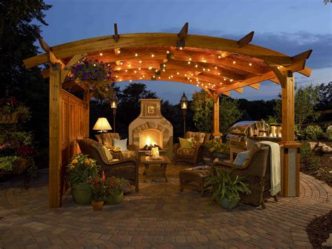 outdoor living and cozy atmosphere a pergola i the string of lights and using potted