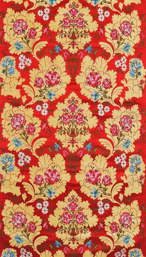 pattern woven into fabric true red fabric from banaras with woven flowers and zari