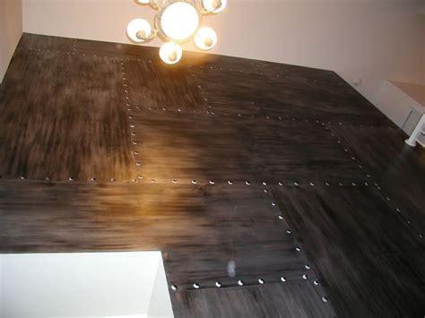 riveted sheet panels brushed metal wall  rivets