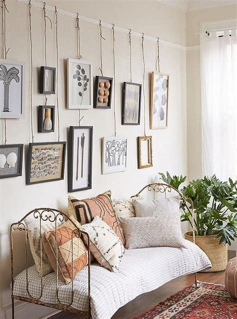 to hang pictures on wall hanging on a picture rail