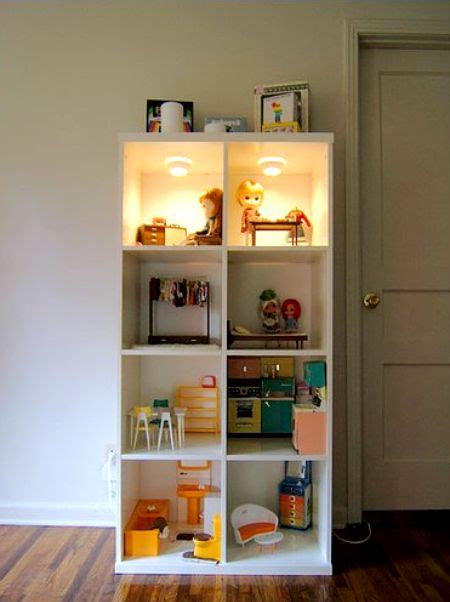 picture of diy dollhouse made of bookcase