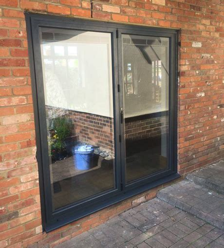 2 pane bi folding door fitted With integral blinds