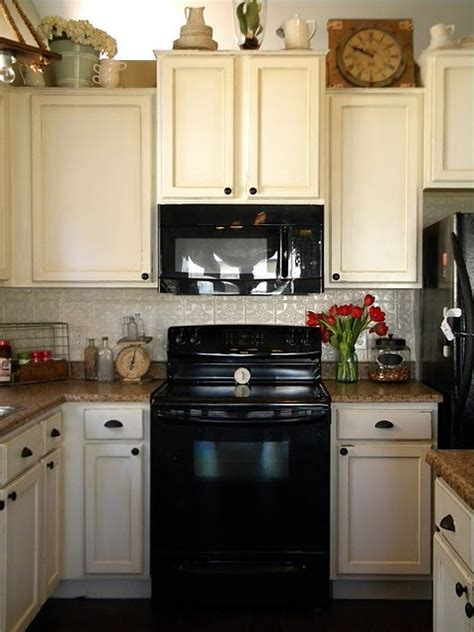 white kitchens with black appliances cabinet color swiss coffee behr check it out also
