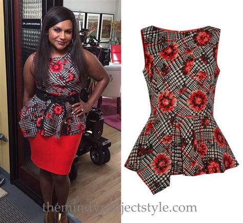 s wearing this houndstooth and floral print asymmetric peplum top on the set of season 4